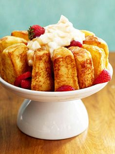 french-toasted angel food cake with strawberries, cream and maple syrup, whoever thought of this is a genius.