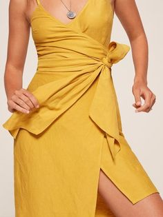 Knot now, I'm busy. This is a midi length, wrap dress with adjustable straps, a v neckline and a sash.