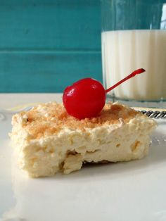 Banana Cream Pie Bars - A low calorie, creamy dessert with a coconut cookie crust that is filled with banana flavored cream and sliced bananas.