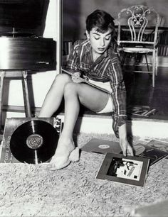 Audrey Hepburn creating a play list the old school way.