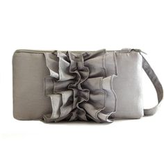 """This gorgeous silver ruffle wristlet is the perfect accessory for a bride or her bridesmaids.  Available to ship within 5 days. Color: Silver Dimension: Regular: 4X8 Large: 5x 10"""" Ruffle detail on the front. Handmade in the USA ------------------ To add personalization:"""