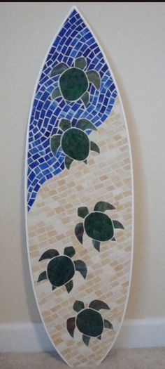 """Turtle Hatchlings Stained Glass Mosaic""  --waves of shades of blue and brown, turtle heading to sea"