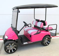 19TH HOLE GOLF CARTS - HOT PINK EZGO GOLF CART WITH CUSTOM UPHOLSTERY