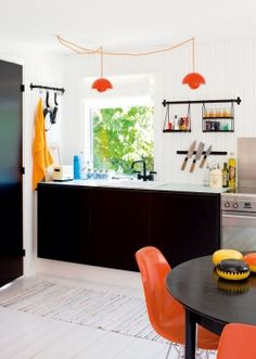 Black cabinetry with minor splash of color.
