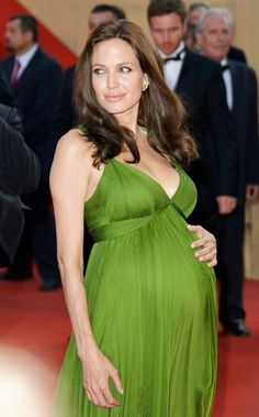 For the Cannes premiere of Kung Fu Panda, Angelina Jolie stunned in a Grecian-style gown from Azria Atelier. Earlier that week, her costar Jack Black spilled the beans that the megastar was expecting twins. Pregnancy Looks, Pregnancy Outfits, Pregnancy Style, Beautiful Pregnancy, Celebrity Maternity Style, Celebrity Photos, Maternity Dresses, Maternity Fashion, Pregnant Dresses