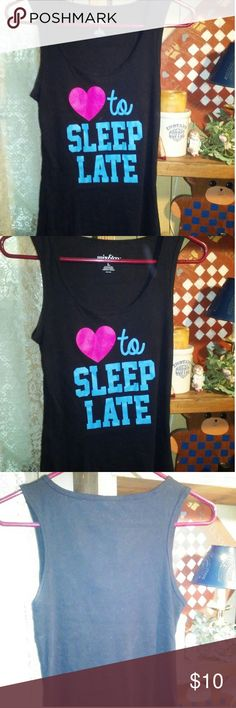 "😴😴""Love to sleep late"" ribbed tank top😴😴 This black ribbed tank top has a big heart on it with the words "" to sleep late"".It is a large. It is 60% cotton and 40% polyester. Perfect for these summer days or nights or layer it in the fall/winter under your favorite sweatshirt for extra warmth. The tank is black with a red heart and the words are in the color blue. mix&co Tops Tank Tops"