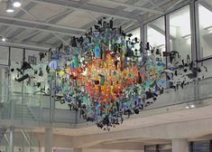 Found objects hung in the atrium of a new London cancer centre by designer Stuart Haygarth