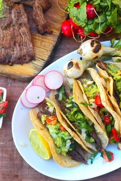 Carne Asada Tacos -  This marinade results in a flavorful tender piece of meat and made for the most delicious tacos! Make sure you also load up on some Pico de gallo and guacamole, because no carne asada would be complete with out it! Happy grilling! -  theseasidebaker