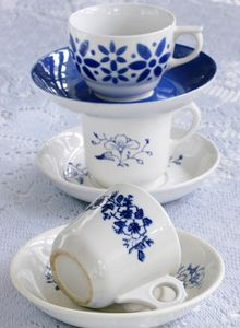 On the top: Coffee cup ans saucer of Arabia, Finland 1950s