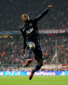 Manchester United's Patrice Evra celebrates after scoring