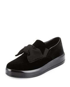 """Prada velvet skate sneaker. 1.5"""" flat platform heel. Round toe. Large grosgrain bow. Notched vamp with stretch insets. Slip-on style. Rubber sole. Imported."""