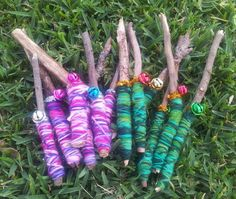 "Musical tapping sticks made using sticks, colourful wool, little metallic bells & sparkly pipe-cleaners from Musical Experiences For Children ("",)"