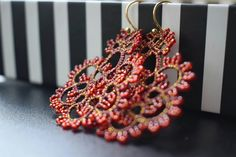 Red-gold tatting earring.