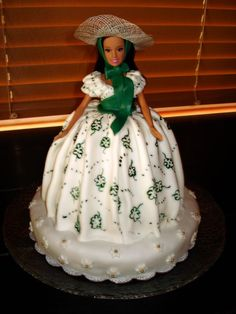 "Scarlett O'hara cake  Love this idea, my aunt Alice made me one with a green skirt (fav color) with a ""skipper"" inside - best cake ever!"