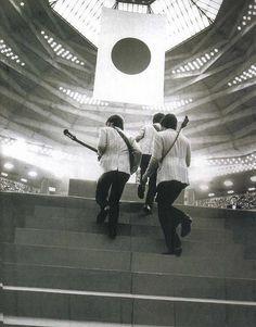 The Beatles step onstage in Tokyo, Japan 1966