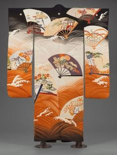 Kimono (furisode) Japanese, Taishô or Shôwa era, late 1920s–1930s, Silk plain-weave crepe (chirimen), resist-dyed (kata- and suri-yûzen) and hand-painted, embroidered with silk, Long-sleeved robe (furisode) with overall, large-scale design of fan shapes decorated with auspicious motifs in blue, green, orange floating on a black, orange and white ground of swirling waves. Five crests.