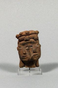 Double faced head. Central America, Mexico, Tlatilco. Middle Pre-Classic period (1200-900 BC). Earthenware, traces of red pigment. h. 4.5 cm. Acquired 1973. Robert and Lisa Sainsbury Collection. UEA 136 . www.scva.ac.uk
