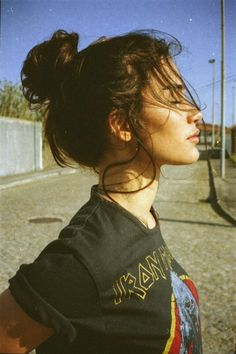 Model with a top knot bun wearing an Iron Maiden t-shirt // urban style