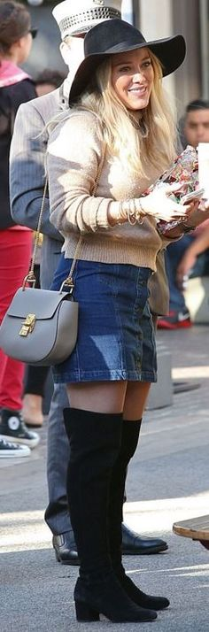 Who made  Hillary Duff's gold jewelry, denim skirt, tan handbag, and black suede thigh high boots?
