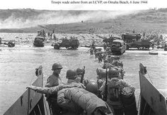 US troops wade ashore from an LCVP on OMAHA Beach
