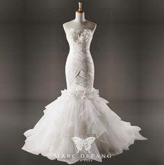 Art no. BG1041 (3D chest floral design, Luxury mermaid bridal wedding gown). $299.00, via Etsy.