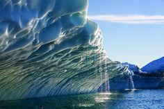 Melting water streams from iceberg calved from Ilulissat Kangerlua Glacier in Disko Bay, Greenland (by Texas A University Division of Research).