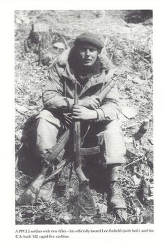 Korean War - Canadian soldier (PPCLI - Princess Patricia's Canadian Light Infantry) armed with a Lee-Enfield Rifle and a M2 Carbine.