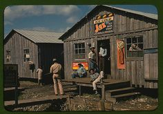 """Negro migratory workers by a """"juke joint"""" (?), Belle Glade, Fla. (LOC)"""