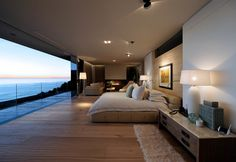 Large Cool Bedroom Ideas For Guys Overlooking Ocean View with Transparent Balcony and Transition between Them