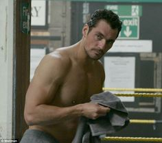 Smouldering: He is one of the world's leading male models and David Gandy proved why when he stripped down to flex his sizeable muscles as part of a new shoot with Vitabiotics Wellman