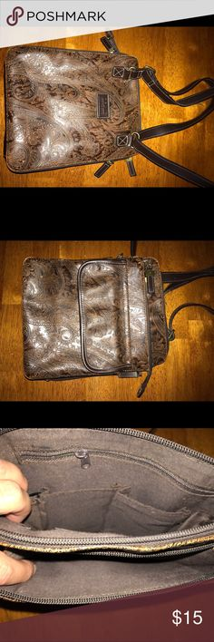 Relic leather cross body Cute cross body leather purse. Has one outside pocket that buttons . 2 separate zipper compartments, one w zippered pocket on the inside. The other has credit card slots and 2 pouch pockets, also zip all the way down to open wide. Slight fraying on the leather handle.Paisley print with distressed look. Very clean. Relic Bags Crossbody Bags