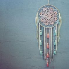 medium handmade dreamcatcher. peach tie dye doily. 7 in. diameter metal ring wrapped in hemp cord