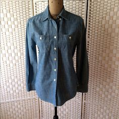 J Crew chambray button down shirt Never worn. Pockets are flat with button closure. J Crew Tops Button Down Shirts