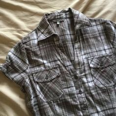 """Charlotte Russe Gray Short Sleeve Plaid Shirt Cute short sleeve button down top! Plaid is gray, white with a hint of pink. V-neck with two small pockets on the front and an elastic gathered spot on the back to give some shape. Worn 1-2 times. 100% Cotton. Measures about 26.5"""" from top of shoulder to longest part on bottom. Charlotte Russe Tops Button Down Shirts"""