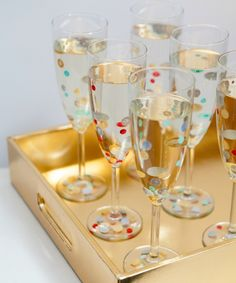 Make polka dot champagne flutes for your next party.