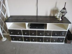 DIY Pottery Barn Inspired Media Console w/ lots of storage! 4 compartments hidden behind these faux drawers.