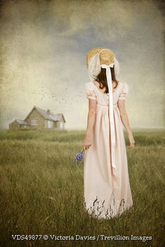 Trevillion Images - historical-woman-in-hat-in-field