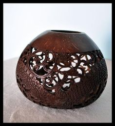 This gorgeous hand-carved coconut shell features ornate dragon designs. Handmade by villagers on an island off the coast of Bali. Diameter 4.7-6.2 IN