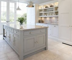 This is  a great plan for a long narrow space with doors on the end....very pretty island too!