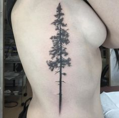 Epic tree tattoo on side by Ash Timlin