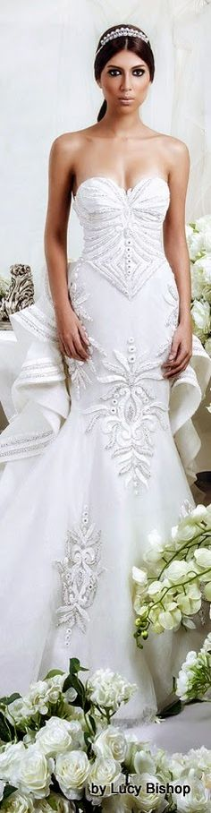 Dar Sara's Wedding Lookbook for 2014  is absolute stunning artistry of wedding couture.! It's Rich and decadent with an extravagant use of S...
