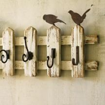 rustic hanging area from picket fence pieces; like the rusted tin birds