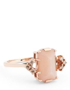 This emerald-cut peach moonstone, with champagne diamonds, on a delicate rose-gold band is seriously stunning.