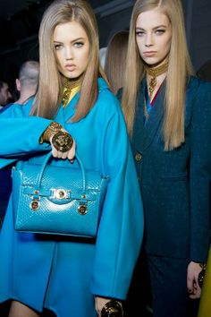 Luxurious bias-cut dresses & the new D. Signature bag backstage at #Versace Women's FW14  from Vogue.com's live Fashion Week coverage.: http://s.chute.cc/rYC