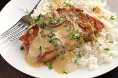 This Crock Pot Onion Pork Chops recipe from Genius Kitchen is perfect for any weeknight dinner or potluck. Pork Chops And Rice, Fried Pork Chops, Pork Loin Chops, Best Baked Pork Chops, Glazed Pork Chops, Sauce Recipes, Pork Recipes, Slow Cooker Recipes, Cooking Recipes