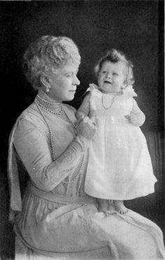 Here Is little Elizabeth with her granny  after whom she was named Mary : Queen Mary who was named :Victoria MARY Augusta Louise Olga Pauline Claudine Agnes Princess of Teck before she was married.