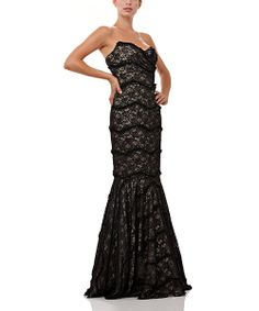 I love this dress!  A strapless sweetheart neckline and mermaid cut define the silhouette of this decadent dress, while a lace finish and generous length add timeless style. It's a look sure to turn heads at any soiree.95% polyester / 5% spandexDry cleanImported
