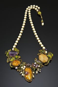~~Summer Gardens by Amolia Willowsong - Center amber stones, citrine and amethyst hang from cream fresh water pearl strand. Accented by fringed pearls, crystals and gold beads~~