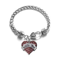 Are you a proud Marines Mom?!  Our sparkling heart bracelet features a 7 1/2 inch braided bracelet complimented with a decorative lobster claw clasp topped with a .925 sterling silver finish! The showcased heart charm is also coated with a sterling silver finish and is accented with 2.5 carats of pave set cubic zirconia stones. Lookout for the matching necklace, earrings, and memory charm! This product is proudly made in the U.S.A!