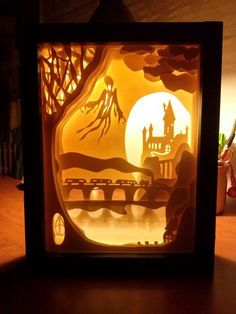 Cut paper shadow box, illuminated with battery powered lights. Harry Potter diorama.